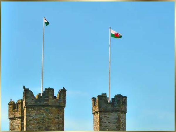 Caernarfon Castle. The national flag of Wales